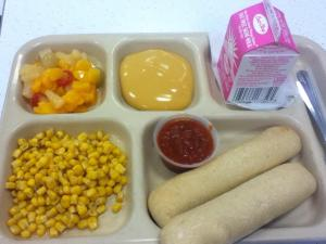 Random shot of an actual high school lunch tray. Can anyone name the major item missing from this tray? (And yes, milk, cheese and bread do contain a bit of this item, so don't get too technical on me.) And by the way, the elementary students only received one breadstick. Lower calorie limits, you know.