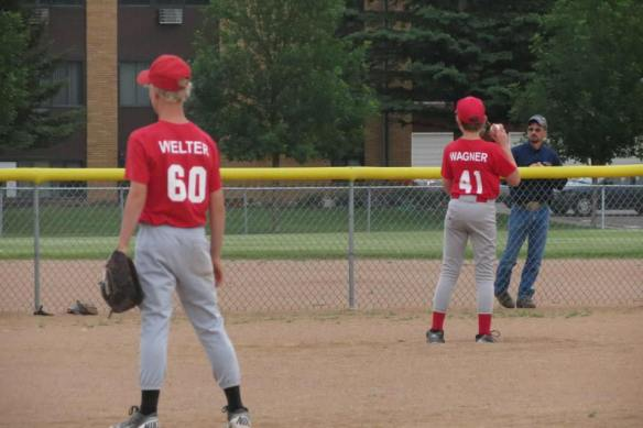 Big Bro even tried his hand at pitching.